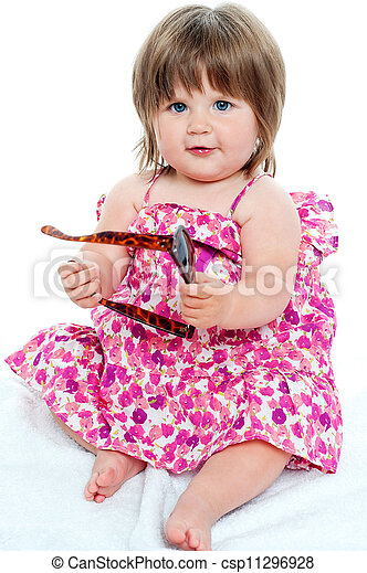 Baby girl sitting with shades in her hand - csp11296928