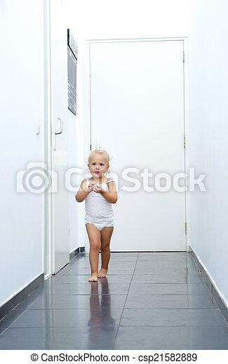 Baby girl walking in hallway at home - csp21582889