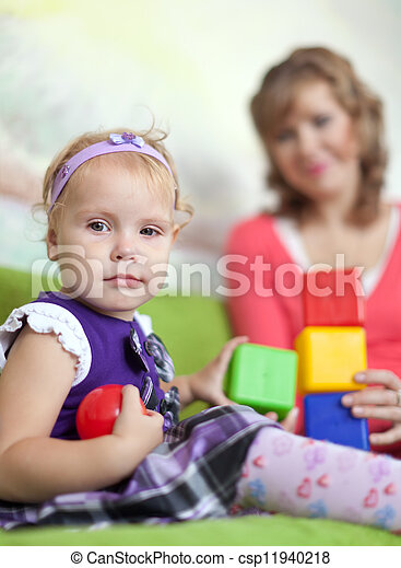 baby girl with mother - csp11940218
