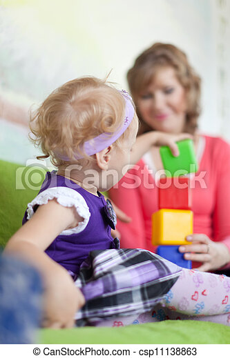baby girl with mother - csp11138863
