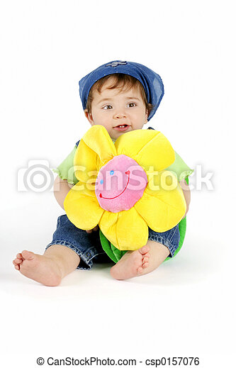 Baby girl with yellow flower - csp0157076