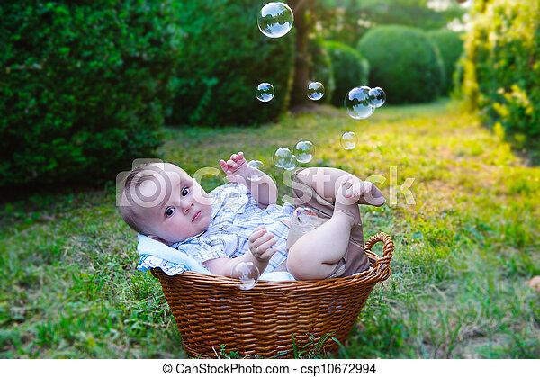 Baby in basket - csp10672994