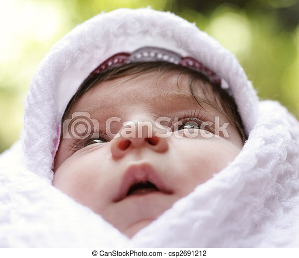Baby in coverlet looking up - csp2691212