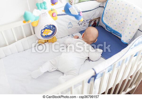 Baby in crib - csp36799157