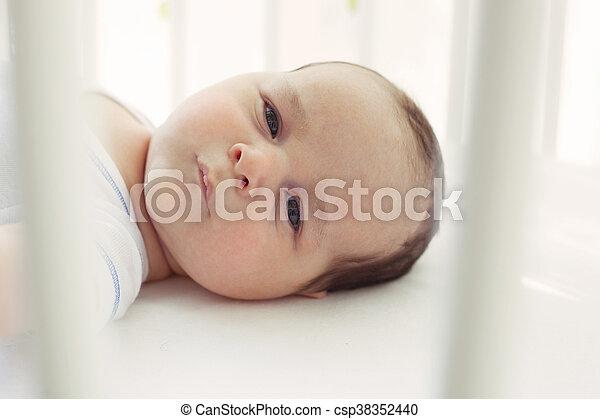 Baby in crib - csp38352440