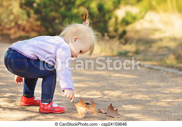 baby in fall time - csp24159646