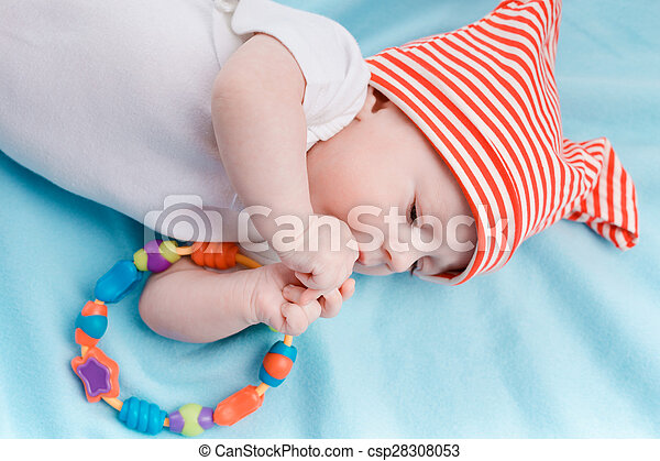Baby in hat lying - csp28308053