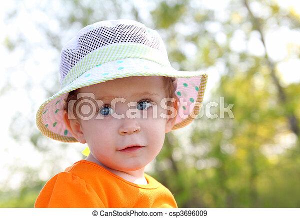baby in hat outdoor - csp3696009