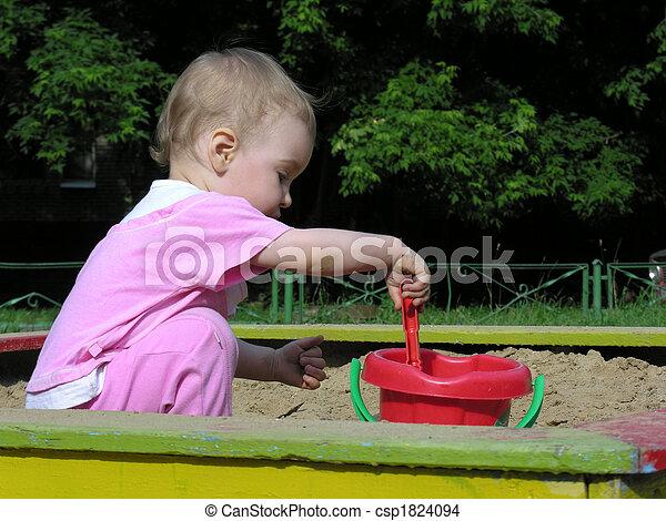 baby in sandbox - csp1824094