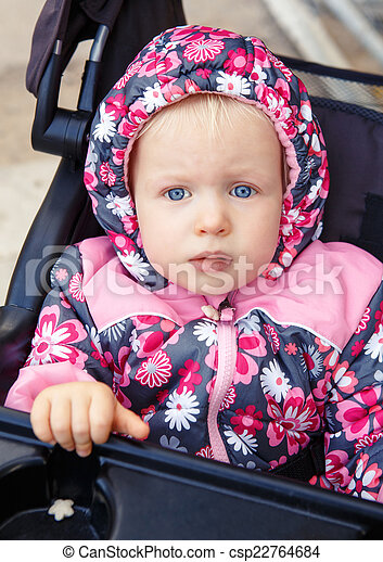 Baby in stroller outside - csp22764684