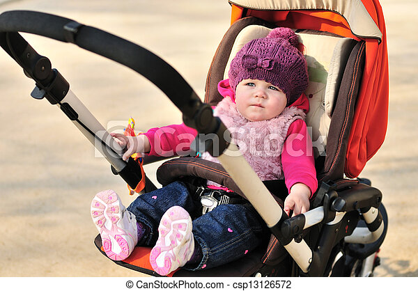 baby in stroller - csp13126572