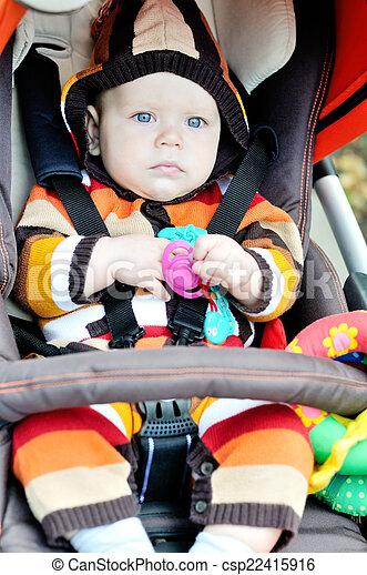 baby in stroller - csp22415916