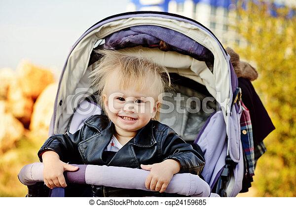 baby  in stroller - csp24159685