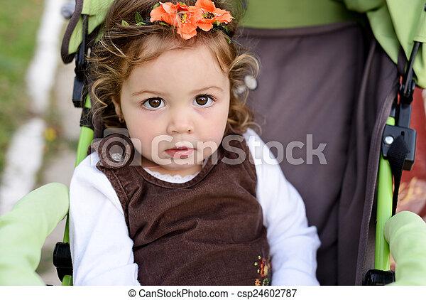 baby in stroller - csp24602787