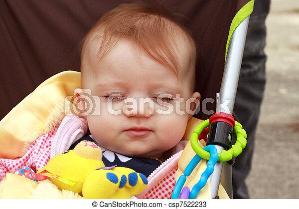 Baby In Stroller Smirk - csp7522233