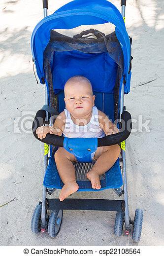 Baby in stroller - csp22108564