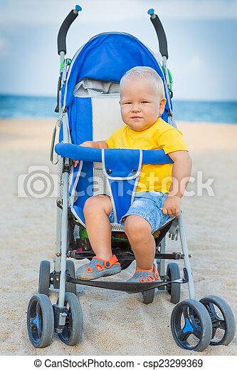 Baby in stroller - csp23299369
