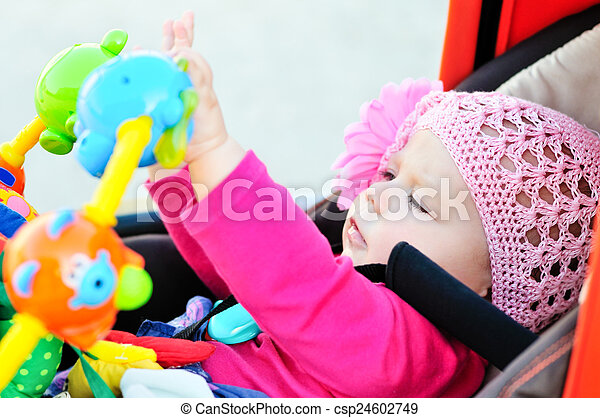 baby in stroller - csp24602749
