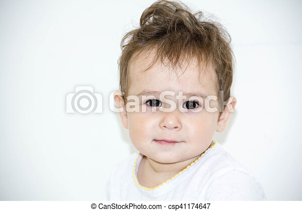 baby infant close-up portrait. looking at camera. on a white towel. Isolated on white. - csp41174647