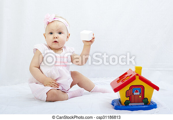 baby is playing with toys over white background - csp31186813