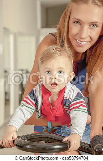 Baby Mother Cycling Jim - csp53794704