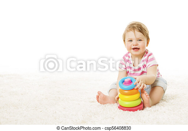 Baby Play Toy Rings Pyramid, Infant Kid Playing Building Blocks, one year Child Sitting on Carpet over White Background - csp56408830