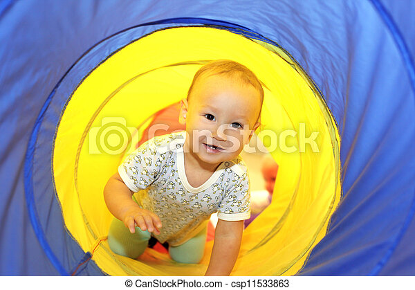 Baby playing in tube - csp11533863