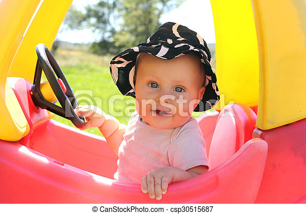Baby PLaying Outside in Toy Car - csp30515687