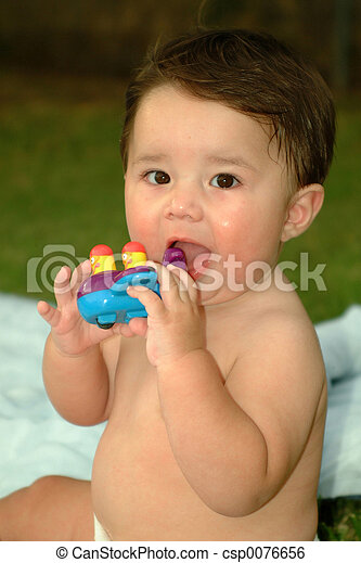 Baby Playing Outside - csp0076656