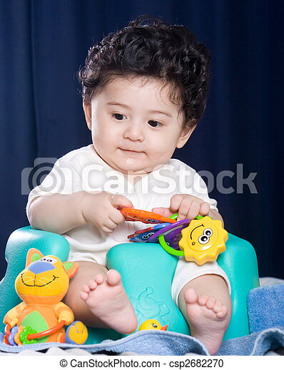 Baby Playing With Toys A Cute 5 Month Old Baby In Bumbo Chair