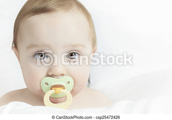 Baby portrait on the bed with white background - csp25472426