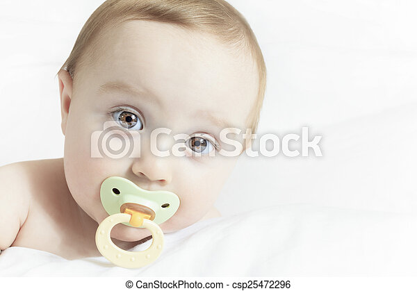 Baby portrait on the bed with white background - csp25472296