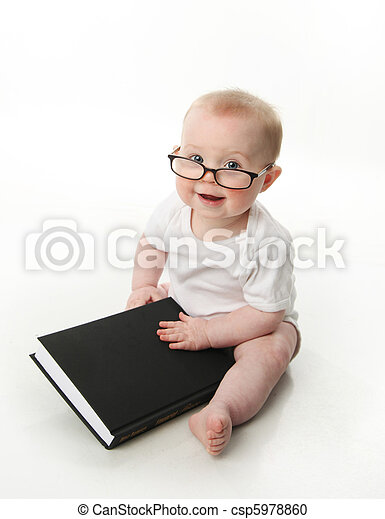 Baby reading wearing glasses - csp5978860