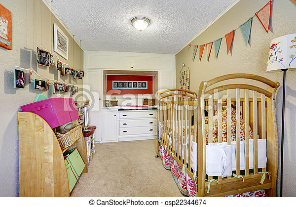 Baby room interior with wooden crib - csp22344674