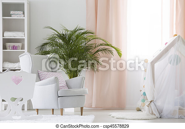 Baby room with armchair, crib and plant - csp45578829