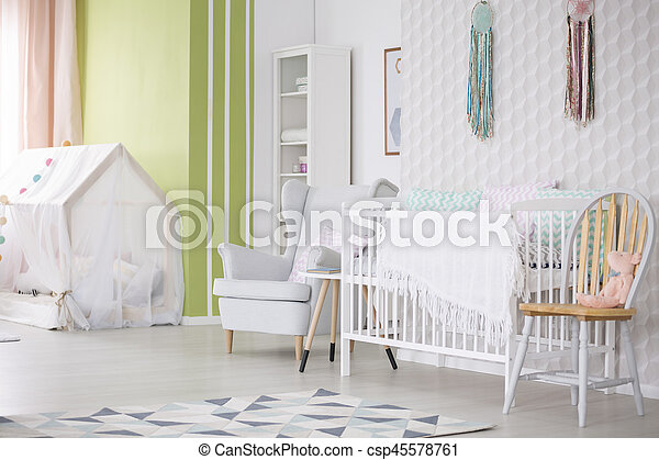 Baby room with chair, armchair and crib - csp45578761