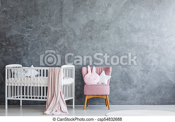 Baby room with crib and armchair - csp54832688