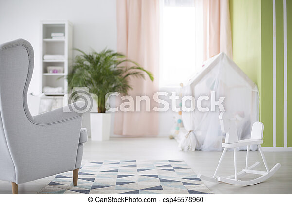 Baby room with rocking horse - csp45578960