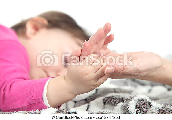 Baby sleeping takes the hand of her mother - csp12747253