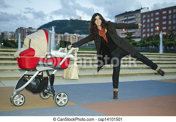 Baby stroller and funny mom - csp14101501