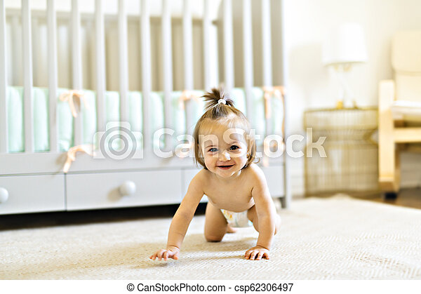 Baby taking time inside baby room crib - csp62306497
