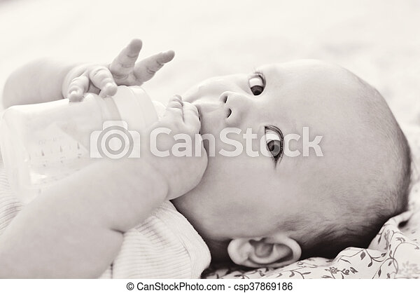 baby with bottle - csp37869186