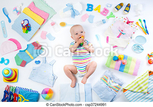 Baby with clothing and infant care items - csp37244991