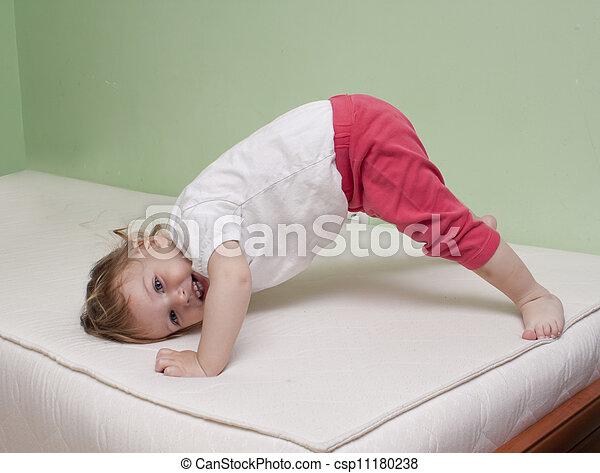 baby yoga exercise baby practice yoga on bed