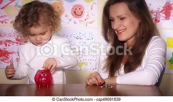 Babysitter and little cute child girl putting coins into... stock ...