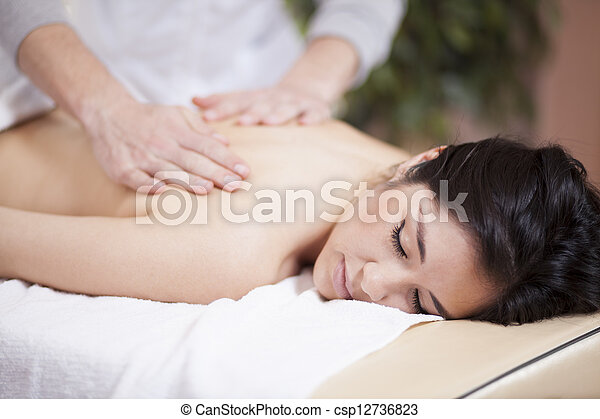 Back massage at a spa - csp12736823