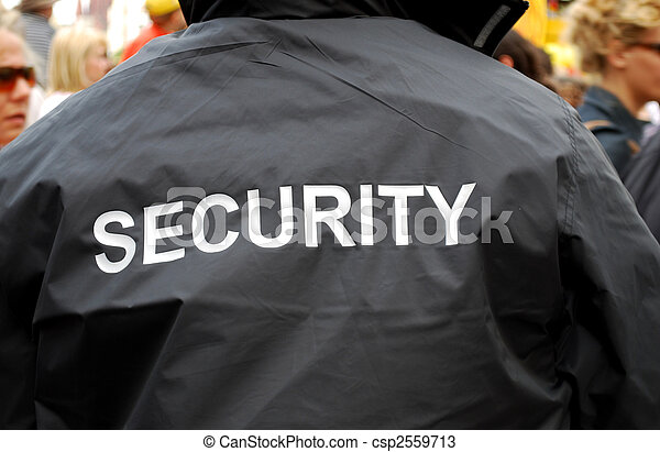 back of a security guardd in black uniform jacket - csp2559713