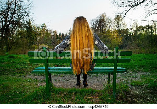 Back Of Blond Hair Woman Sitting On Park Bench Back Of Blond Hair