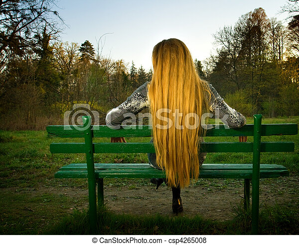 Back Of Woman Sitting Alone On Park Bench Back Of Blond Woman