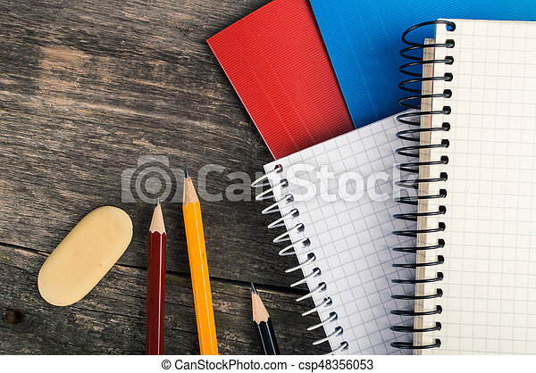Back to School, supplies, notebook on the grey background, top view - csp48356053